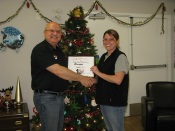 Russell Scott presents Rhonda Gardiner of Cheshire Homes of Saskatoon the 7,000th Food Safety 1st certificate.
