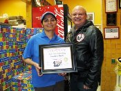 Russell Scott presents Hardeep Hothi of Pizza 73 - 8th Street, Saskatoon the 6,000th Food Safety 1st certificate.